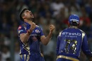 Karn Sharma exults after dismissing Ajinkya Rahane, Mumbai Indians v Rising Pune Supergiant, Qualifier 1, IPL, Mumbai, May 16, 2017