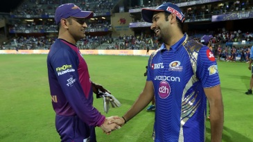 MS Dhoni and Rohit Sharma share a moment after the end of the qualifier