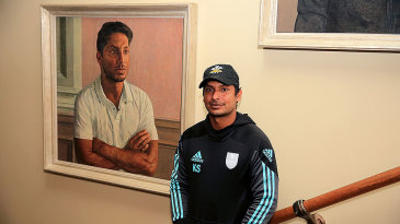 Kumar Sangakkara poses in front of his newly unveiled portrait in the Lord's Pavilion