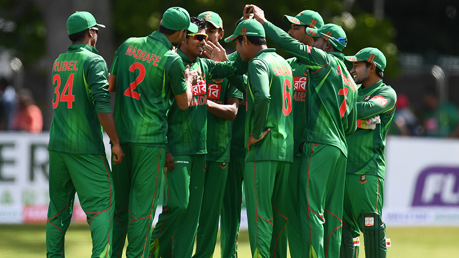 Team-mates mob Mosaddek Hossain after he dismissed William Porterfield