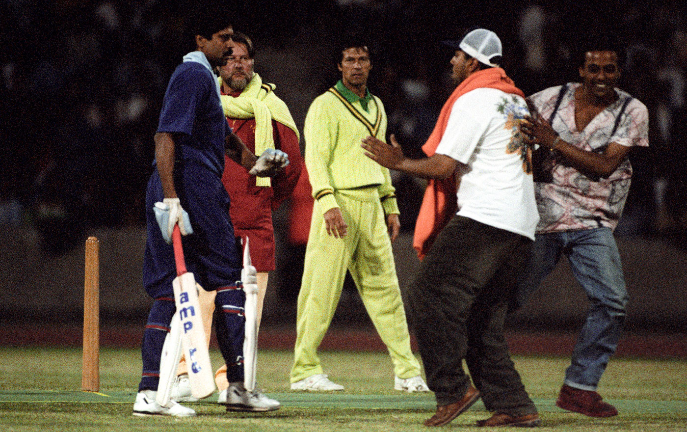 Fans invade the pitch during a India-Pakistan charity game at Crystal Palace in 1992