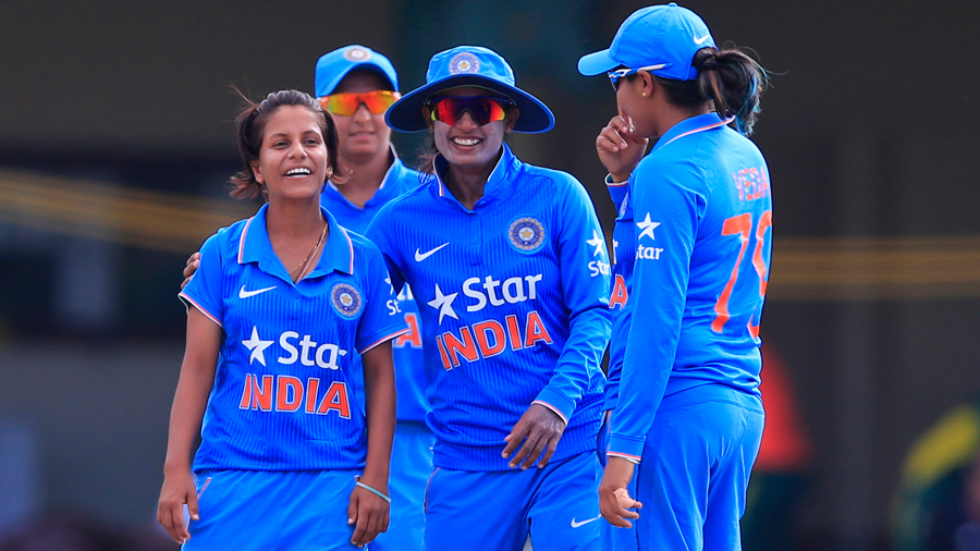 Poonam Yadav gets a hug from Mithali Raj after picking up the wicket of Marizanne Kapp