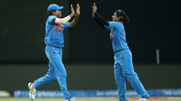 Jhulan Goswami and Mithali Raj celebrate the wicket of Bismah Maroof