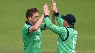 Craig Young celebrates a wicket