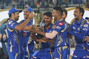 Rohit Sharma passes on the trophy to his delighted team-mates, Mumbai Indians v Rising Pune Supergiant, IPL final, Hyderabad, May 21, 2017