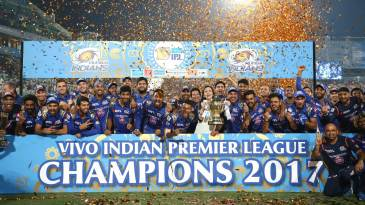 The Mumbai Indians team pose with the trophy