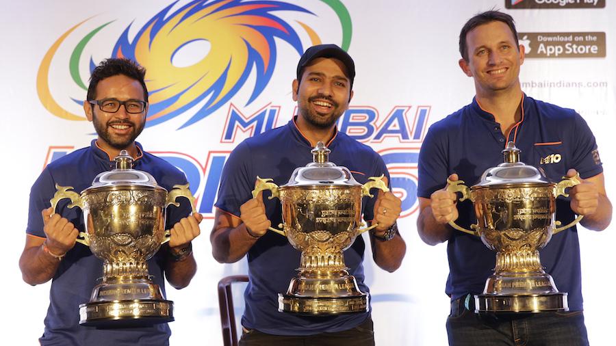 Parthiv Patel, Rohit Sharma and Shane Bond pose with the three IPL trophies
