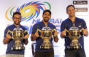 Parthiv Patel, Rohit Sharma and Shane Bond pose with the three IPL trophies Mumbai Indians have won, Mumbai, May 22, 2017