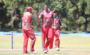 Khawar Ali gets high-fived after taking the wicket of Ibrahim Khaleel, Oman v USA, ICC World Cricket League Division Three, Entebbe, May 23, 2017