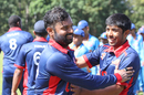 Ibrahim Khaleel gets congratulated by his room-mate Sagar Patel after finishing 49 not out, Malaysia v USA, ICC World Cricket League Division Three, Kampala, May 24, 2017