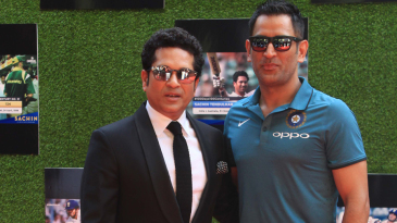 MS Dhoni poses with Sachin Tendulkar at the screening of the latter's biopic
