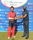 Arjun Mutreja accepts the Man of the Match award from ICC official Gurjit Singh, Singapore v USA, ICC World Cricket League Division Three, Kampala, May 26, 2017
