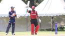 Dhanuka Pathirana raises his bat after reaching a half-century, Canada v USA, ICC World Cricket League Division Three, Kampala, May 27, 2017