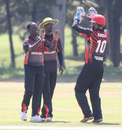 Left-arm spinner Henry Ssenyondo celebrates the wicket of Ibrahim Khaleel, Uganda v USA, ICC World Cricket League Division Three, Entebbe, May 29, 2017