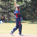 Elmore Hutchinson raises his bat after reaching a half-century, Uganda v USA, ICC World Cricket League Division Three, Entebbe, May 29, 2017