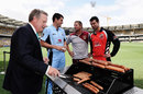 Moises Henriques, James Hopes and Callum Ferguson watch Ian Healy cook sausages, Brisbanem October 2, 2014