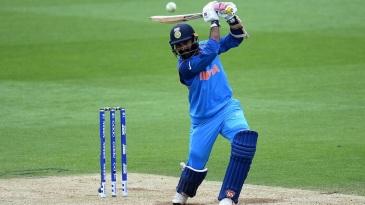 Dinesh Karthik hits one down the ground