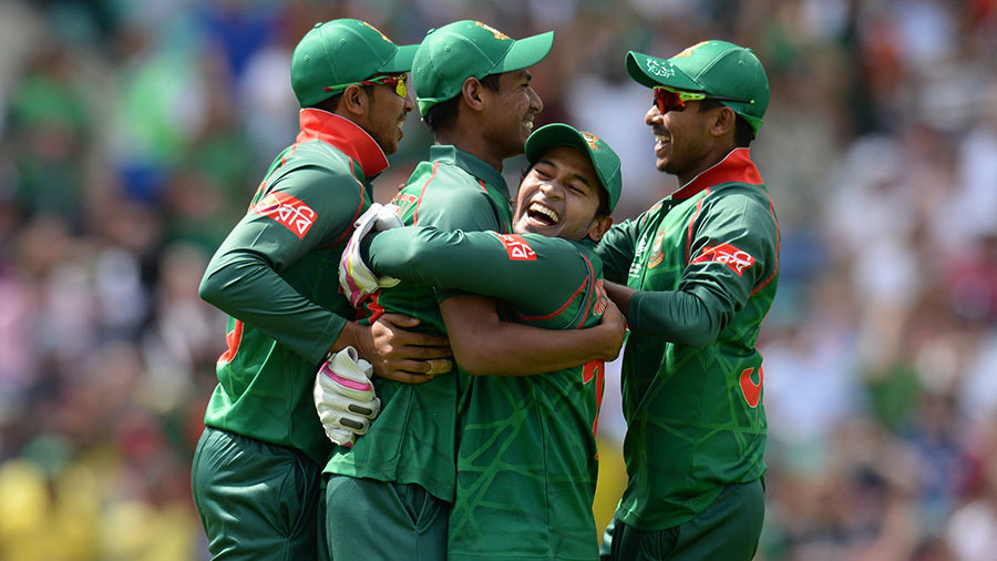 Mushfiqur Rahim embraces Mustafizur Rahman after his catch to remove Jason Roy