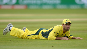 Glenn Maxwell looks on after the ball evaded him