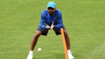 Dinesh Karthik prepares to collect a throw at a training session on match eve