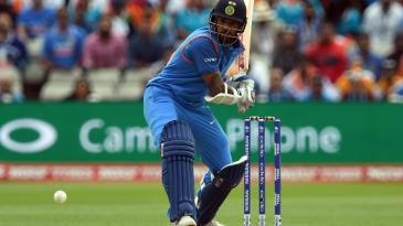 Shikhar Dhawan keeps a close eye on the ball