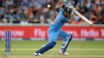 Virat Kohli opens his bat face to steer one behind point