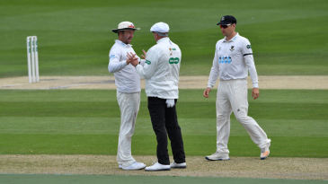 Sussex captain Chris Nash debates a decision with umpire Neil Mallender.