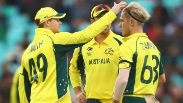 Part-time hairdresser: Steven Smith fiddles with Adam Zampa's hair after a wicket