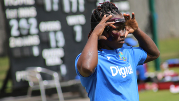 Deandra Dottin fixes her protective face mask during a training session