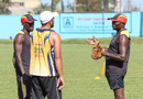 Uganda coach Steve Tikolo talks to Frank Nsubuga and Mohammed Irfan during a training session, ICC World Cricket League Division Three, Kampala, May 25, 2017