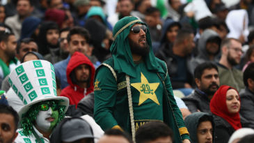 Pakistan fans wait for the rain to clear