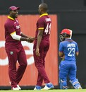 Miguel Cummins and Ashley Nurse celebrate a wicket, West Indies v Afghanistan, 1st ODI, St Lucia, June 9, 2017