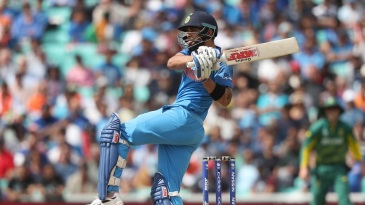 Virat Kohli watches the ball fly off his pull shot