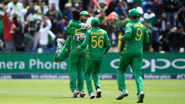 Sarfraz Ahmed embraces Mohammad Amir after they combined to dismiss Niroshan Dickwella