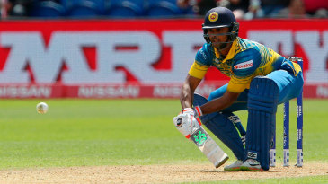 Asela Gunaratne gets low to play a reverse-ramp