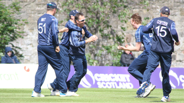 Con de Lange gets mobbed after a stunning catch to remove Craig Williams,