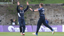 Con de Lange gives Richie Berrington a high-five for taking the wicket of Gerhard Erasmus, Scotland v Namibia, ICC WCL Championship, Edinburgh, June 12, 2017