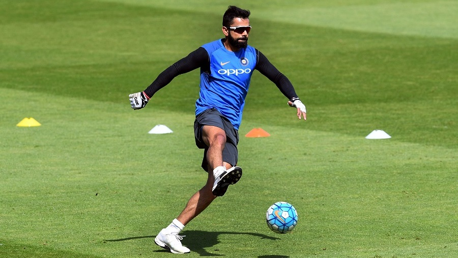 Virat Kohli warms up with some football at a practice session on match eve