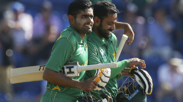 Babar Azam and Mohammad Hafeez walk off victorious