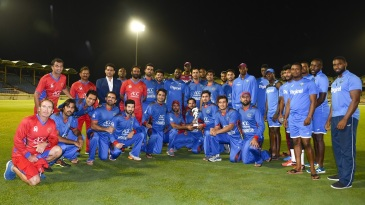 West Indies and Afghanistan players pose for a photograph after the third ODI was washed out