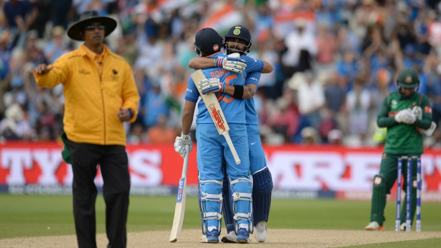Virat Kohli and Rohit Sharma embrace after India completed the win