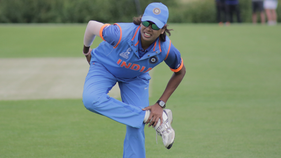Jhulan Goswami goes through a warm-up routine ahead of the start of play