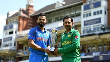 The captains Virat Kohli and Sarfraz Ahmed pose with the Champions Trophy in front of the famed pavillion at The Oval