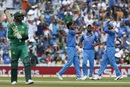 Bhuvneshwar Kumar celebrates with team-mates after dismissing Shoaib Malik, India v Pakistan, Final, Champions Trophy 2017, The Oval, London, June 18, 2017