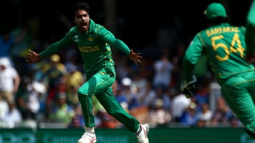 Mohammad Amir takes flight after picking up a wicket