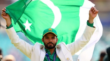 Azhar Ali holds the Pakistan flag aloft after their win in the final