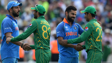 Junaid Khan and Shadab Khan shake hands with Yuvraj Singh and Virat Kohli