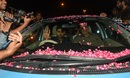 Babar Azam leaves the airport with his car draped in rose petals, Lahore, June 20, 2017