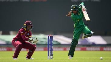 Nain Abidi punches the ball down the ground