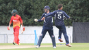 Con de Lange and Matthew Cross celebrate Sikandar Raza runout as rain comes down, Scotland v Zimbabwe, 1st ODI, Edinburgh, June 15, 2017